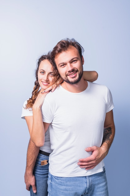 Woman hugging man from behind Free Photo