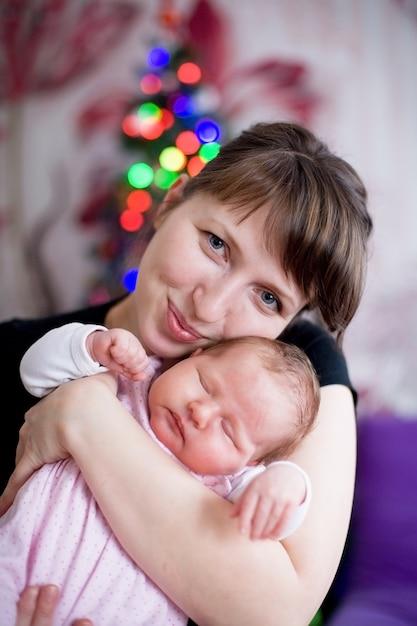 Woman hugging a sleeping baby Premium Photo