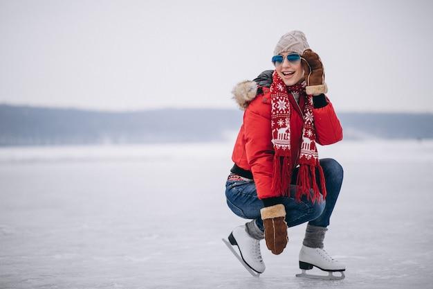 Woman ice skating at the lake Free Photo