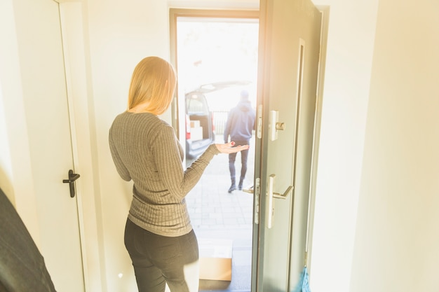 Woman in doorway having mail Free Photo