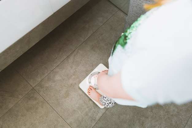 Woman in light clothes in bathroom Free Photo