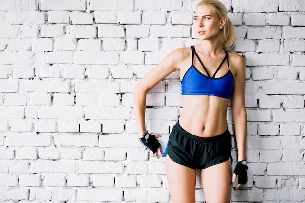 Woman in sportswear looking away Free Photo