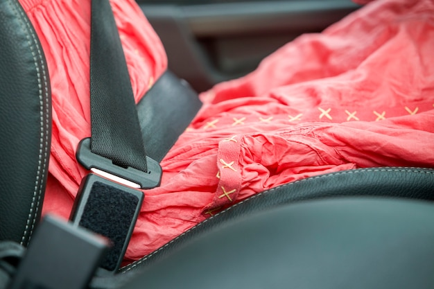 Woman inside car buckled up with protective seat belt. Premium Photo