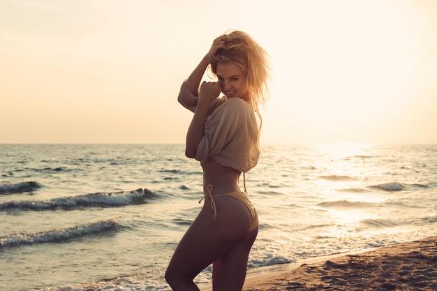 Woman is alone at beach Premium Photo