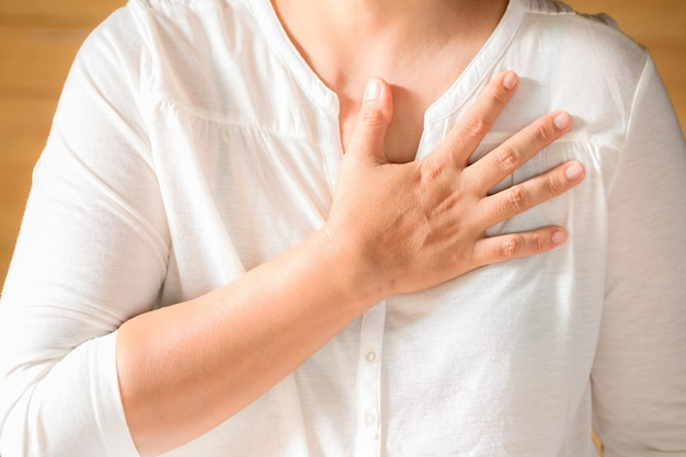 Woman is clutching her chest Free Photo