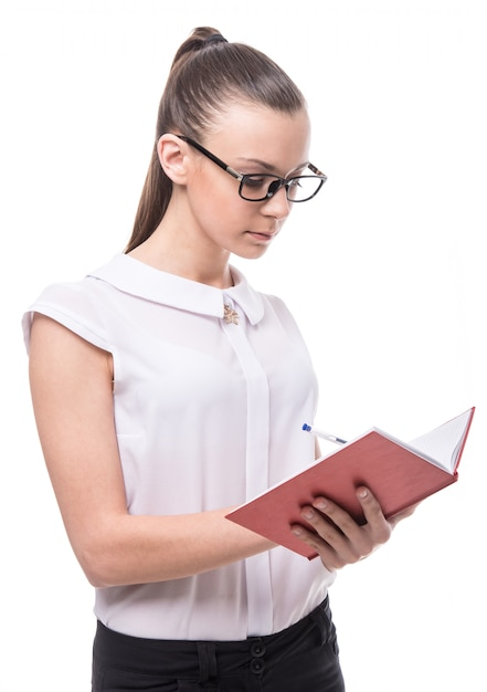 Woman is holding notebook Premium Photo