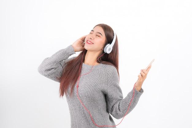 Woman is listening to music. Premium Photo
