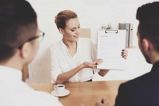 Woman is showing resume at job interview Premium Photo