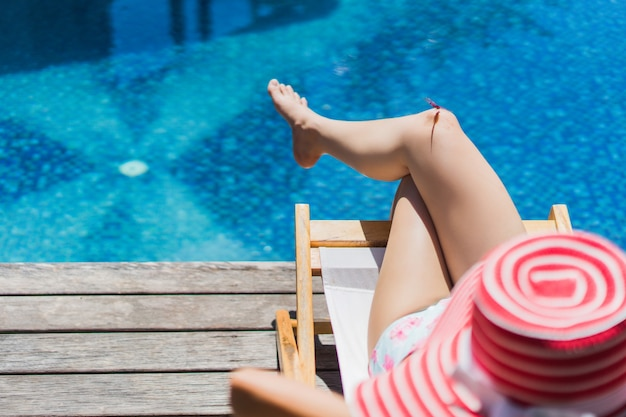 Woman is sitting in a chair relaxing in the summer Premium Photo