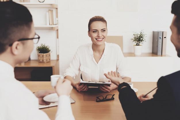 Woman is sitting at job interview. Premium Photo