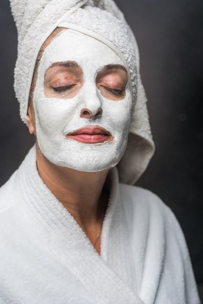 Woman is white clay on his face mask Premium Photo