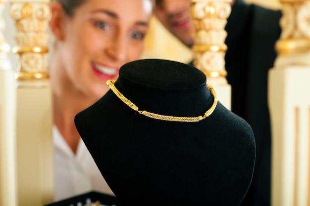 Woman at the jeweller Premium Photo