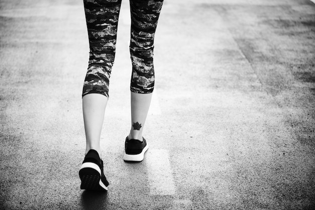 Woman jogging down the road Free Photo