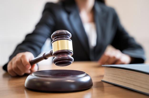 Premium Photo | Woman judge hand holding gavel to bang on sounding block