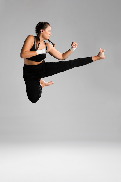 Woman jumping with copy space background Free Photo