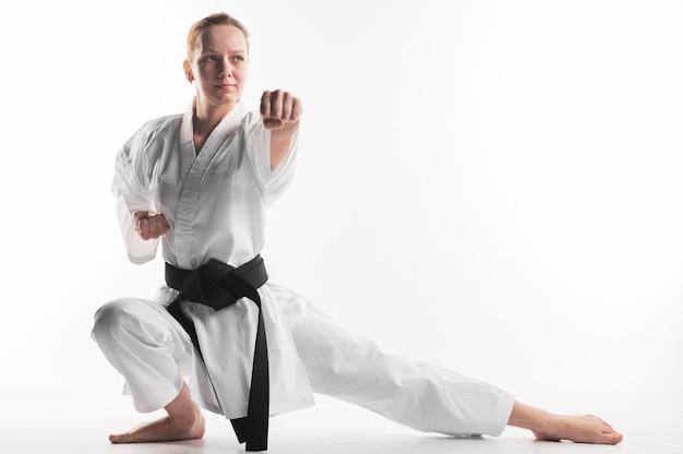 Woman in karate pose full shot Free Photo