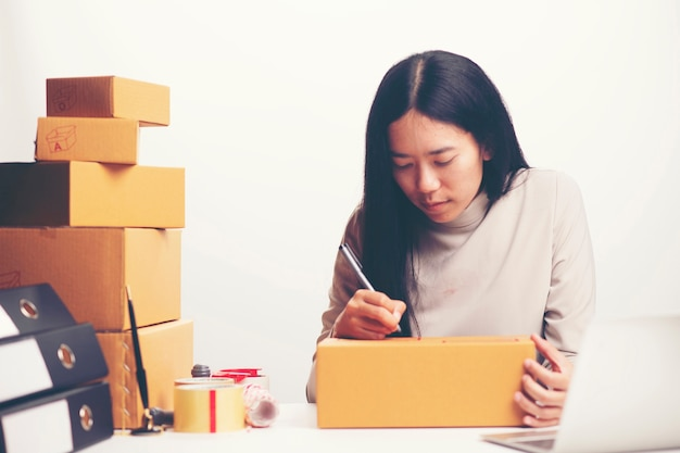 Woman labeling moving box at home Premium Photo