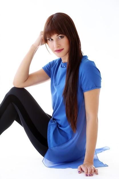 Woman in leggings sitting on the floor Free Photo