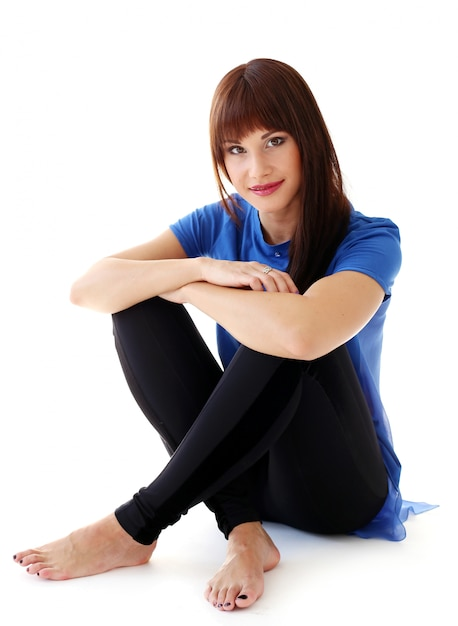 Woman in leggings sitting on the floor Free Photo