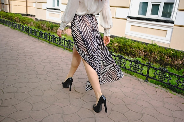 Woman legs close-up in high fashionable clothing Free Photo
