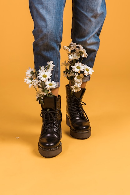 Woman legs with flowers in shoes Free Photo