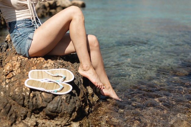 Woman legs with water background Free Photo