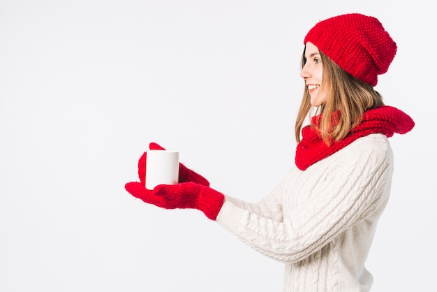 Woman in light sweater holding cup Free Photo
