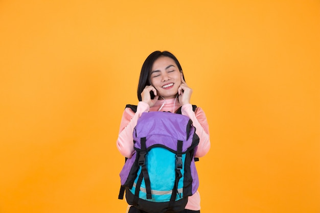 Woman listening to music and schoolbag Premium Photo