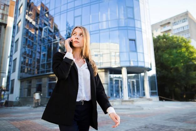 Woman looking away while walking Free Photo