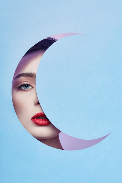 Woman looking blue moon month hole Premium Photo