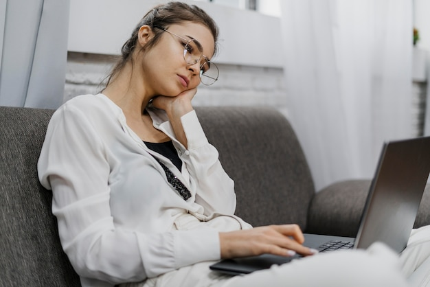 Woman looking bored while working Free Photo