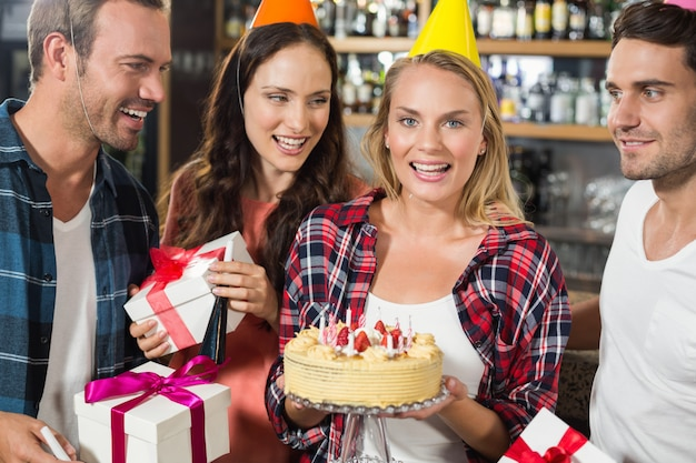 Woman looking at camera with cake in hands Premium Photo