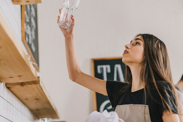 Woman looking at clean glass Free Photo