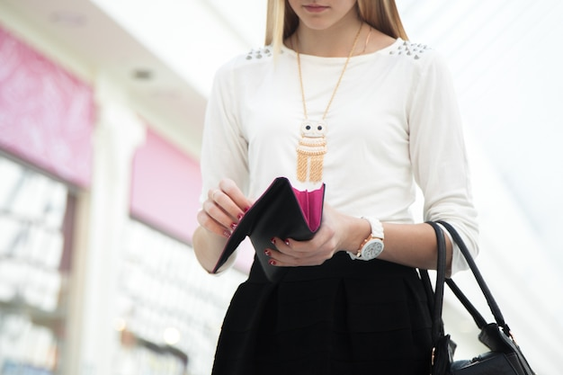 Woman looking at her purse Premium Photo