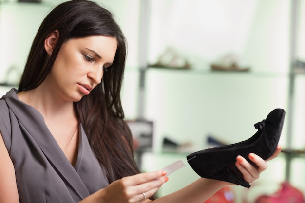 Woman  looking at the price tag Premium Photo