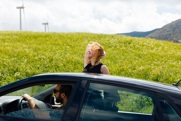Woman looking at road out of car window Free Photo