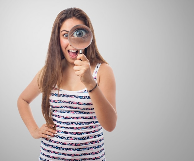 Woman Looking Through A Magnifying Glass Photo