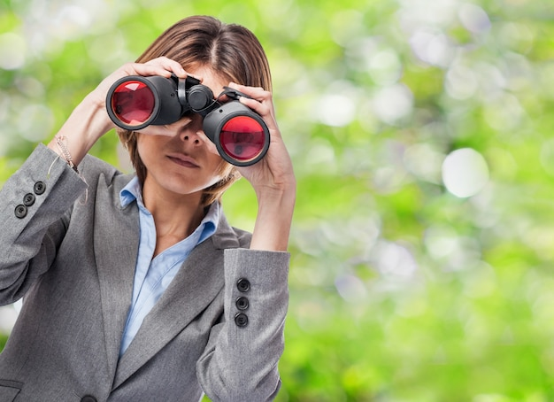 Woman looking through binoculars Photo | Free Download