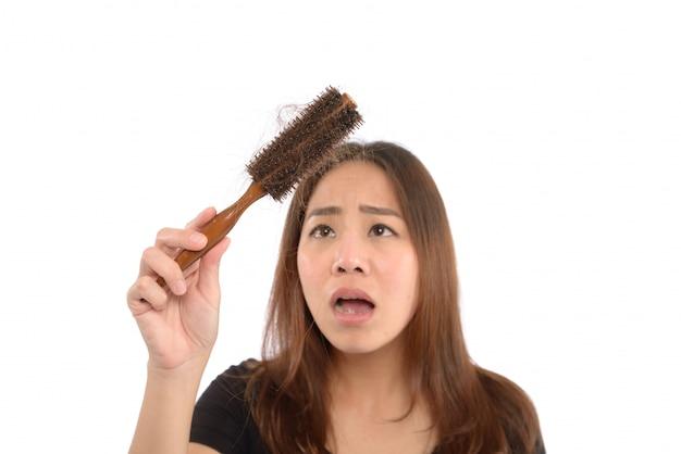 Woman losing hair on hairbrush isolated on white Premium Photo