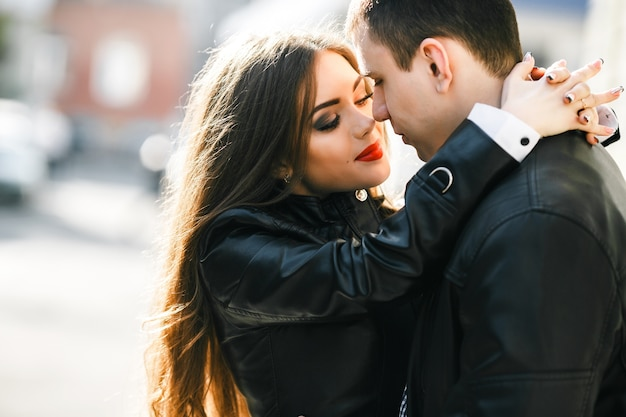 Woman in love with hands on her boyfriend's neck Free Photo