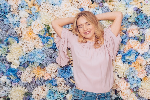 Woman lying on bright flowers Free Photo