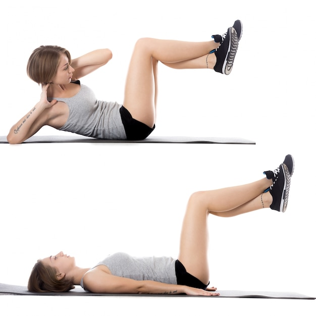 Woman lying on the floor while doing sit-ups Free Photo