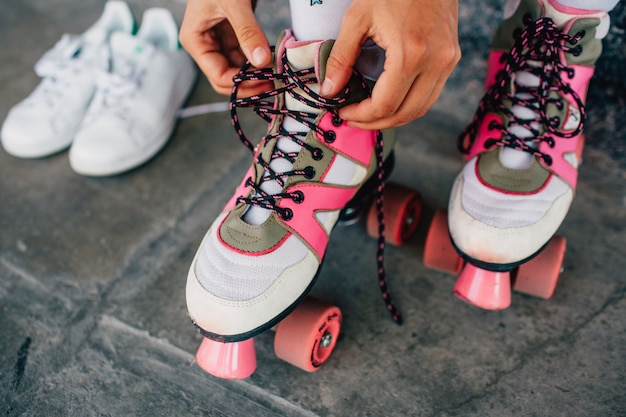 Woman lying laces on her pink rollers Premium Photo
