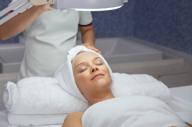 Woman lying in the massage room face up Free Photo