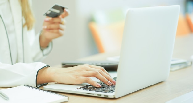 Woman make a payment online with credit card concept. Premium Photo