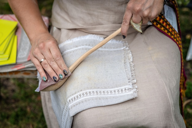The woman makes traditional handcraft wooden spoon. Premium Photo