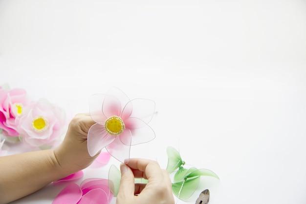 Woman making beautiful nylon flower Free Photo