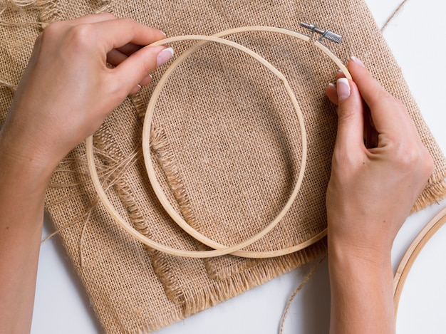 Woman making decorations with wood rings Free Photo