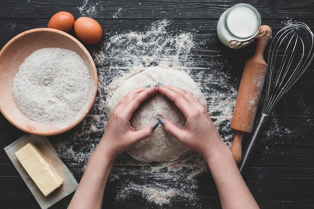 Woman making delicious bread loaf Free Photo