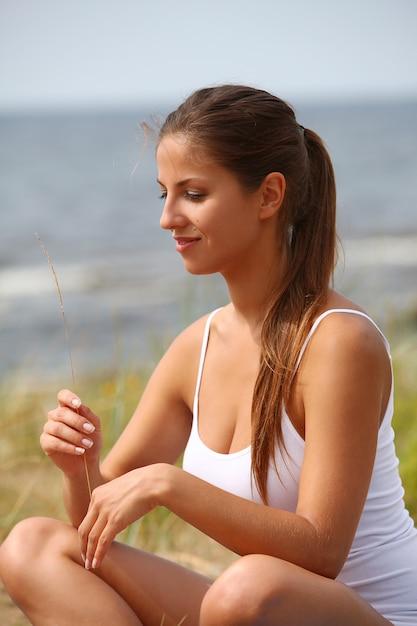 Woman making yoga at the beach Free Photo